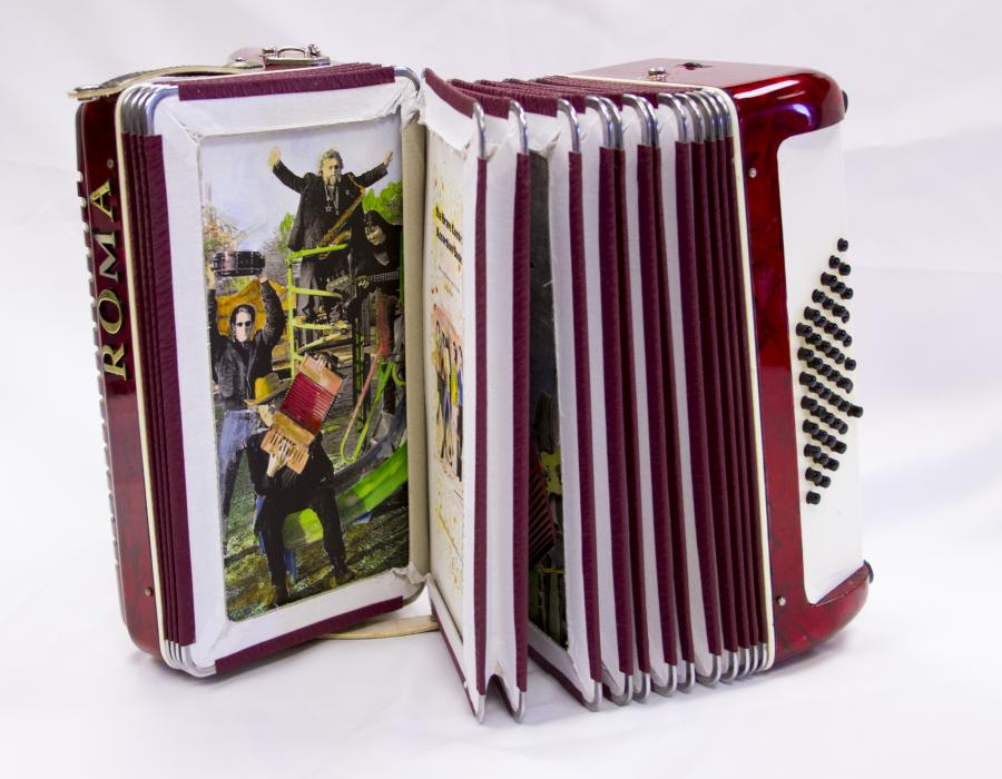 Open accordion book. The page is open to a photograph of four men on using different instruments.