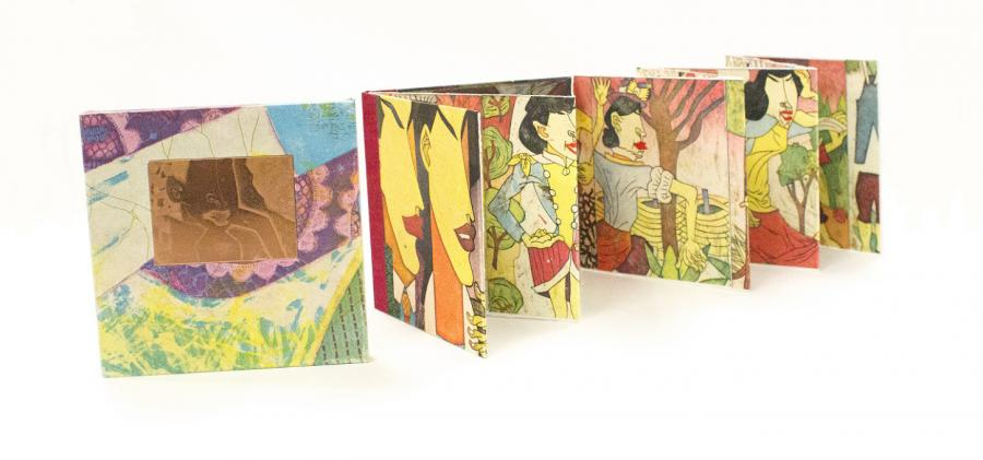 A book open like an accordion, colorful illustrations on it.