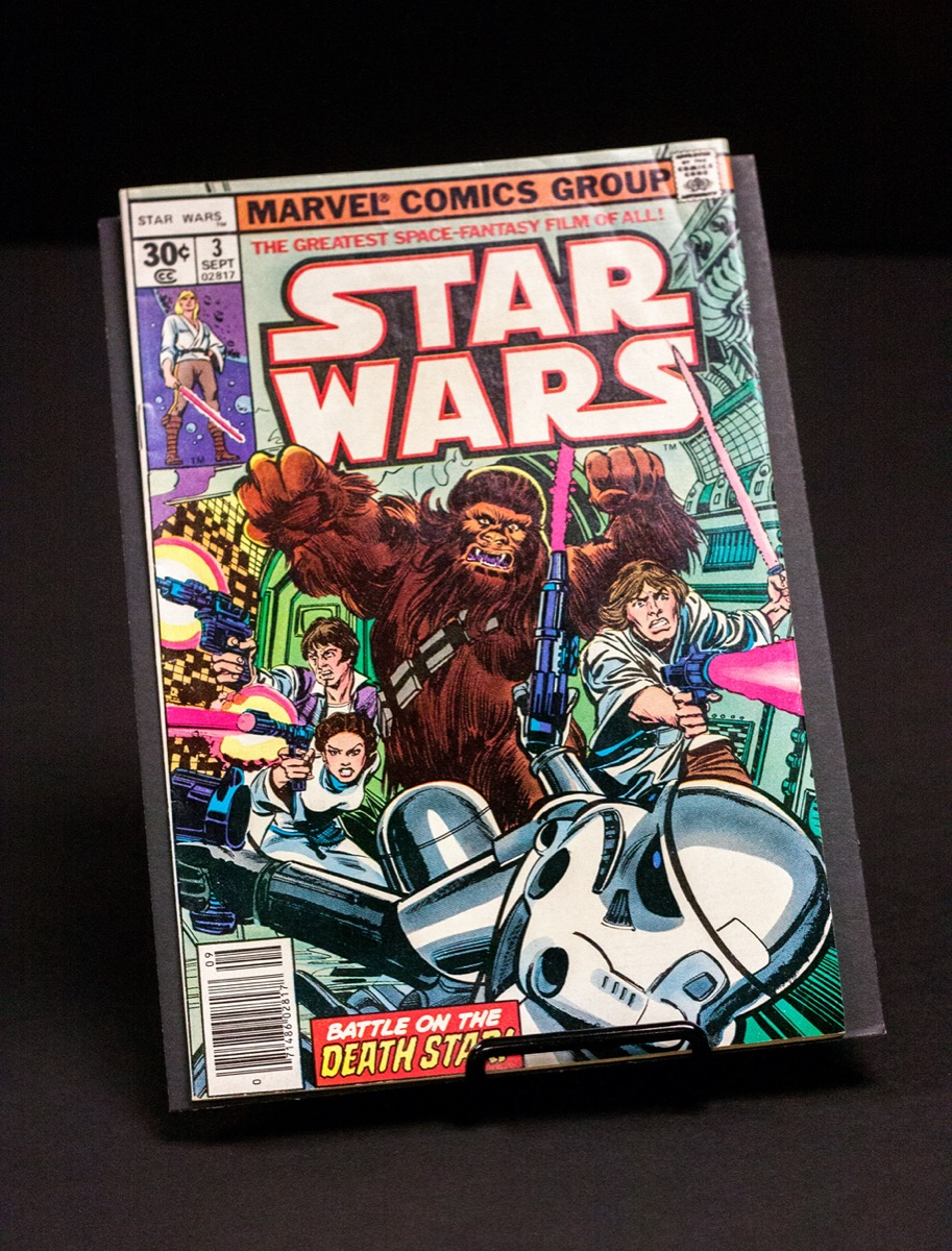 A colorful comic book cover of Star Wars, with Chewbacca as the main character. The title of it says Star Wars in white letters outlined with orange.