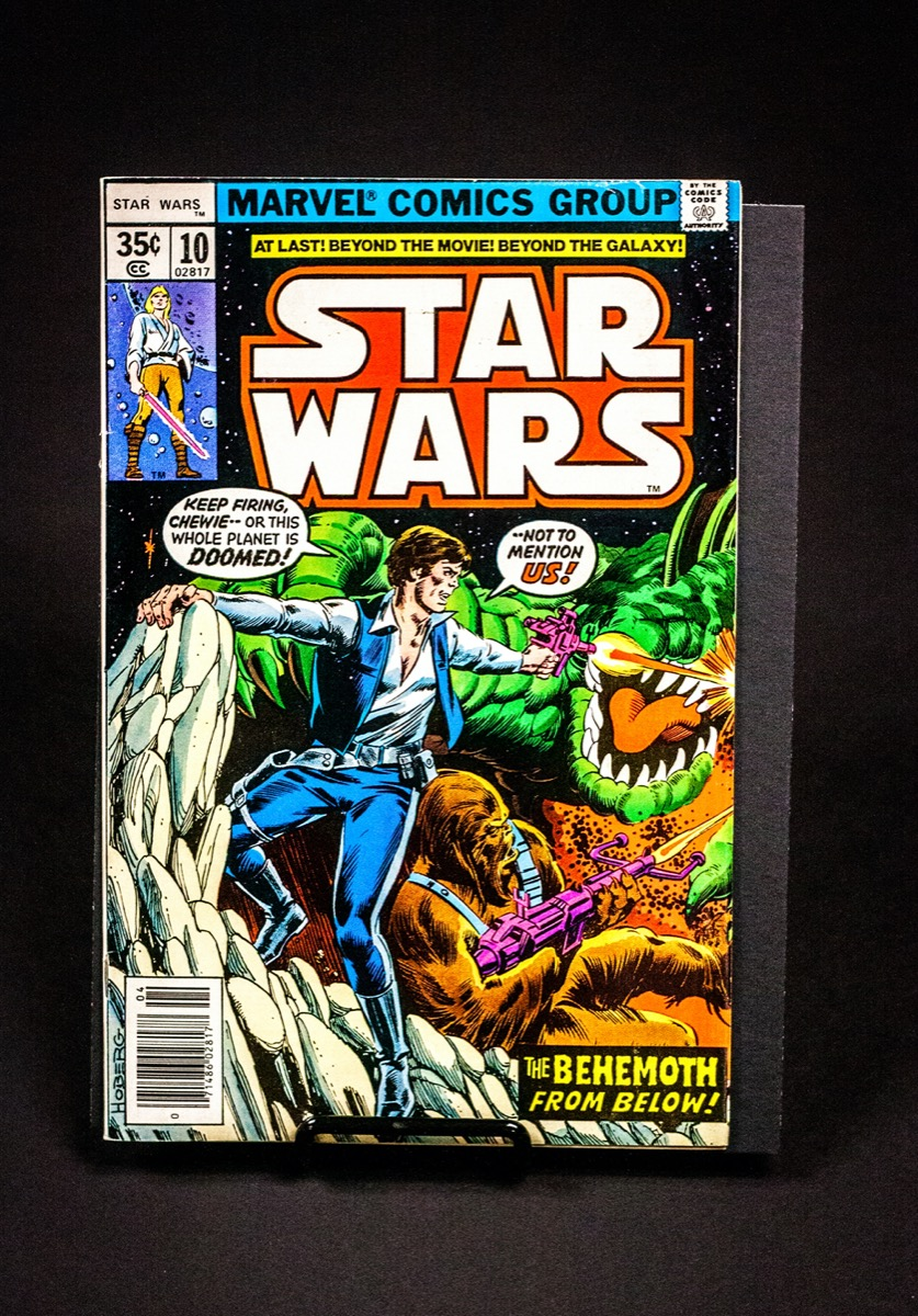 A colorful comic book cover of Star Wars with Han solo fighting some aliens with Chewbacca.