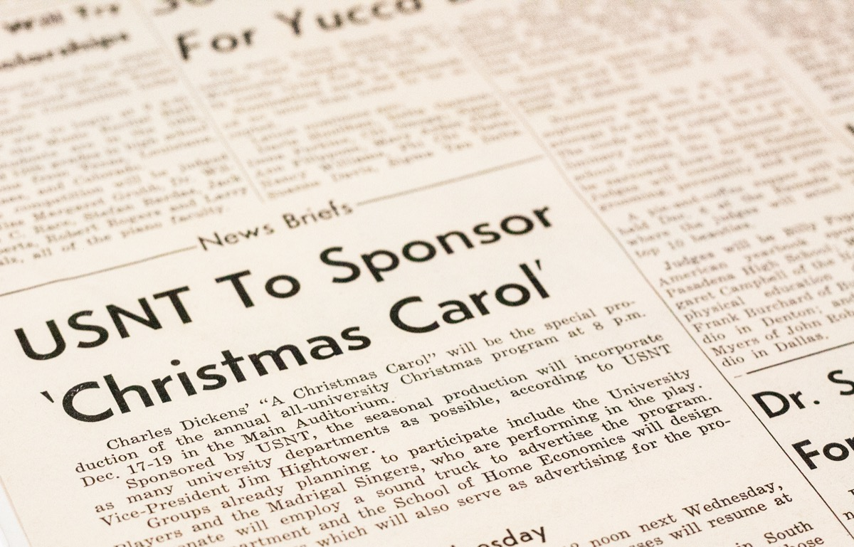 Closeup of a newspaper page, showing a news story titled USNT To Sponsor Christmas Carol.