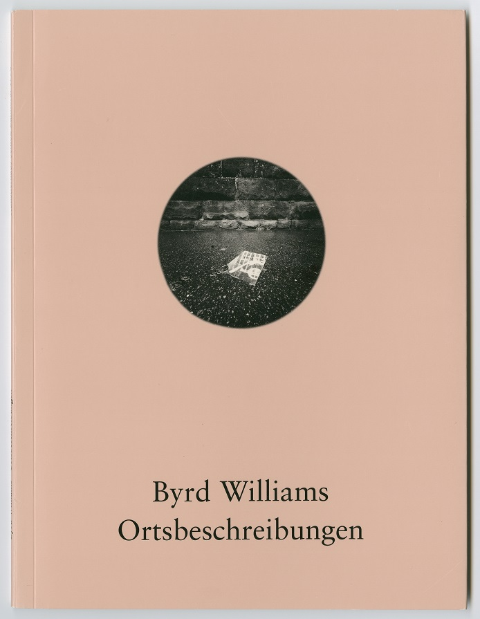 Light pink book cover. In the middle of it is a black and white photo in the shape of a circle. The bottom of it has a name in black.