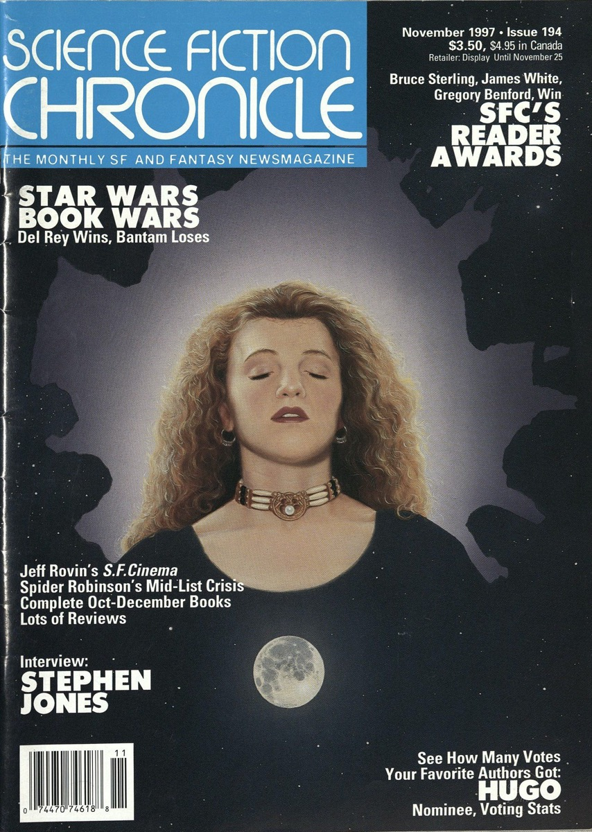 A magazine front cover, the title of it in the top left corner, white letters in a blue box. The cover is a picture of a womans head in a starry dark sky. She has long curly blonde hair, and a golf choker on her neck. Over her head is a splotch of light purple. Underneath her is a full, bright moon.