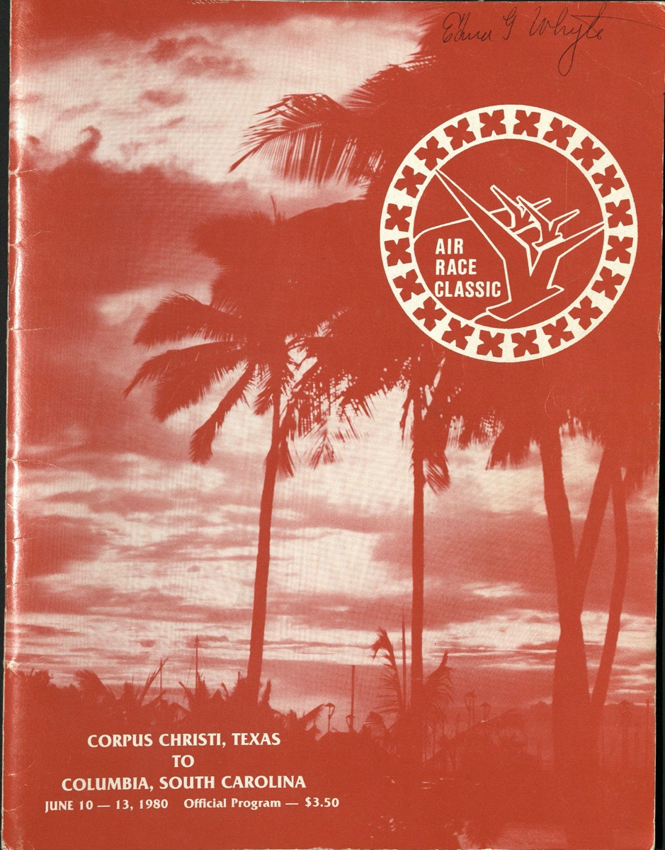 A program cover, showing a photo of palm trees and a cloudy sky tinted red-orange in color .
